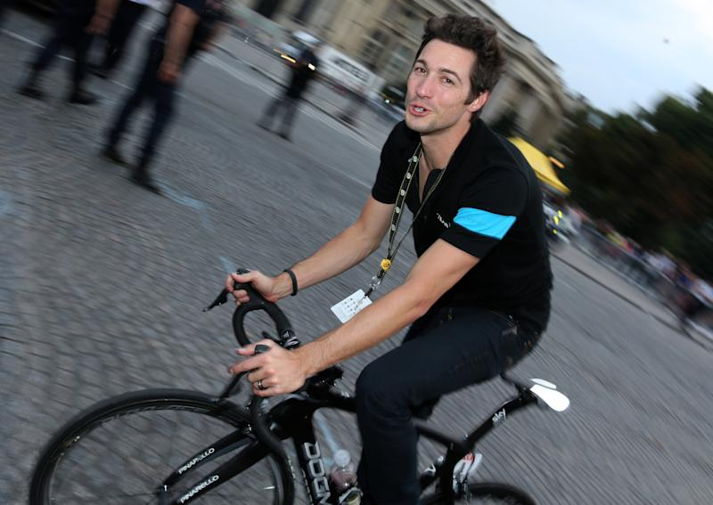 Sports director of Team Sky Nicolas Portal rides a bike during the lap of honor after the twenty one and last stage of the 2014 Tour de France, a 134 km individual time trial stage between Evry and the Champs-Elysees in Paris on July 27, 2014 in Paris France. (Photo by Jean Catuffe/Getty Images)