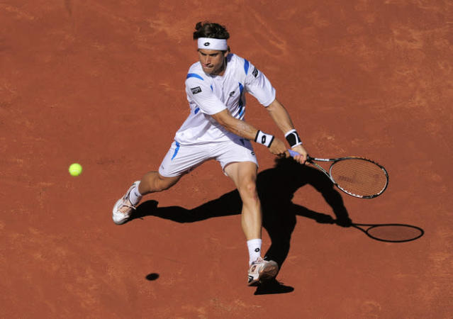 Spanish David Ferrer returns the ball to his compatriot Rafael Nadal during the final of the Barcelona Open tennis tournament Conde de Godo on April 29, 2012 in Barcelona. Nadal won 7-6, 7-5. AFP PHOTO / JOSEP LAGOJOSEP LAGO/AFP/GettyImages