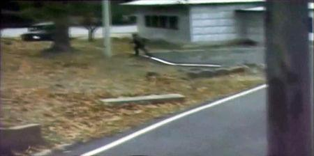 A CCTV footage shows a North Korean soldier crossing the white Military Demarcation Line during a United Nations Command (UNC) briefing on the investigation results of the soldier's defection, at the South Korean defence ministry in Seoul in this still image taken from a Reuters TV video, November 22, 2017. REUTERS/Reuters TV