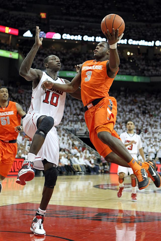 LOUISVILLE, KY - FEBRUARY 13:  Dion Waiters #3 of the Syracuse Orange shoots the ball while defended by Gorgui Dieng #10 of the Louisville Cardinals during the Big East Conference game at KFC YUM! Center on February 13, 2012 in Louisville, Kentucky.  (Photo by Andy Lyons/Getty Images)