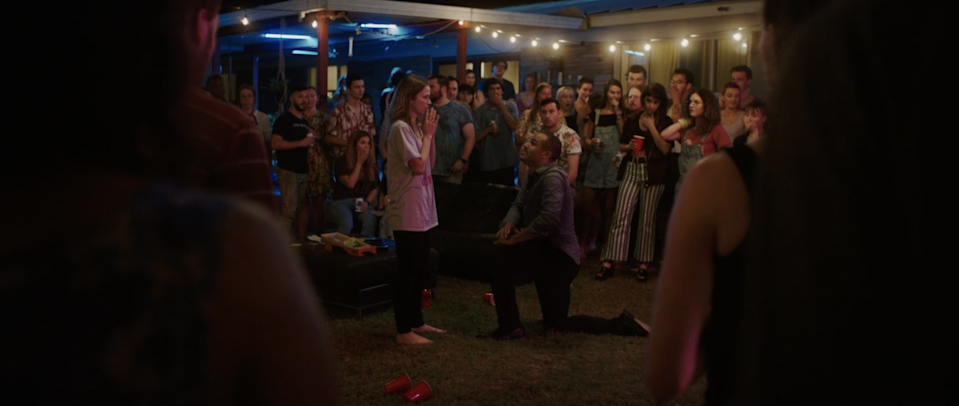 """All eyes are on a young couple (Johanna Braddy and Jacob Artist) at a raucous Austin shindig in """"The Get Together."""""""