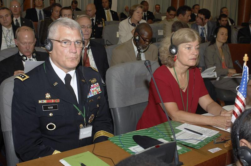 U.S Gen. Carter Ham, in charge of U.S forces for Africa, left, sits with an unidentified delegation member at the conference on anti-terrorism in the Sahel desert region, Wednesday, Sept. 7, 2011 in Algiers. The foreign ministers of Algeria and other North African nations met Wednesday to discuss how to confront terrorism in the vast desolate regions of the Sahara Desert. The two-day conference, originally expected to focus just on al-Qaida, has now also become inextricably tied up with the civil war in neighboring Libya. (AP Photo/Anis  Belghoul)