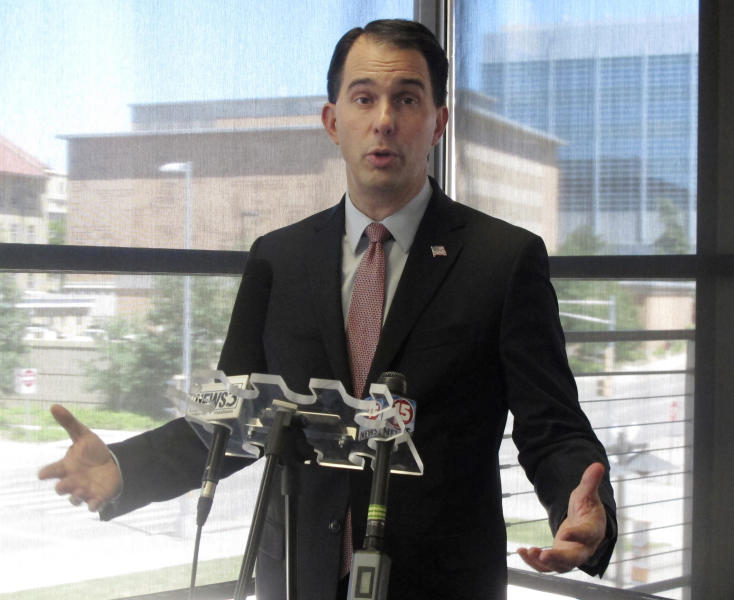 FILE - In this June 7, 2017 file photo, Wisconsin Gov. Scott Walker speaks to reporters during a news conference in Madison, Wis. The Republican former presidential hopeful sent a letter Monday Oct. 16, 2017 to NFL Commissioner Roger Goodell and Players Association Executive Director DeMaurice Smith saying he believes players are showing disrespect for the flag and veterans. Former San Francisco 49ers quarterback Colin Kaepernick started the protests last season when he refused to stand during the anthem to protest racial inequality and police brutality. (AP Photo/Scott Bauer File)
