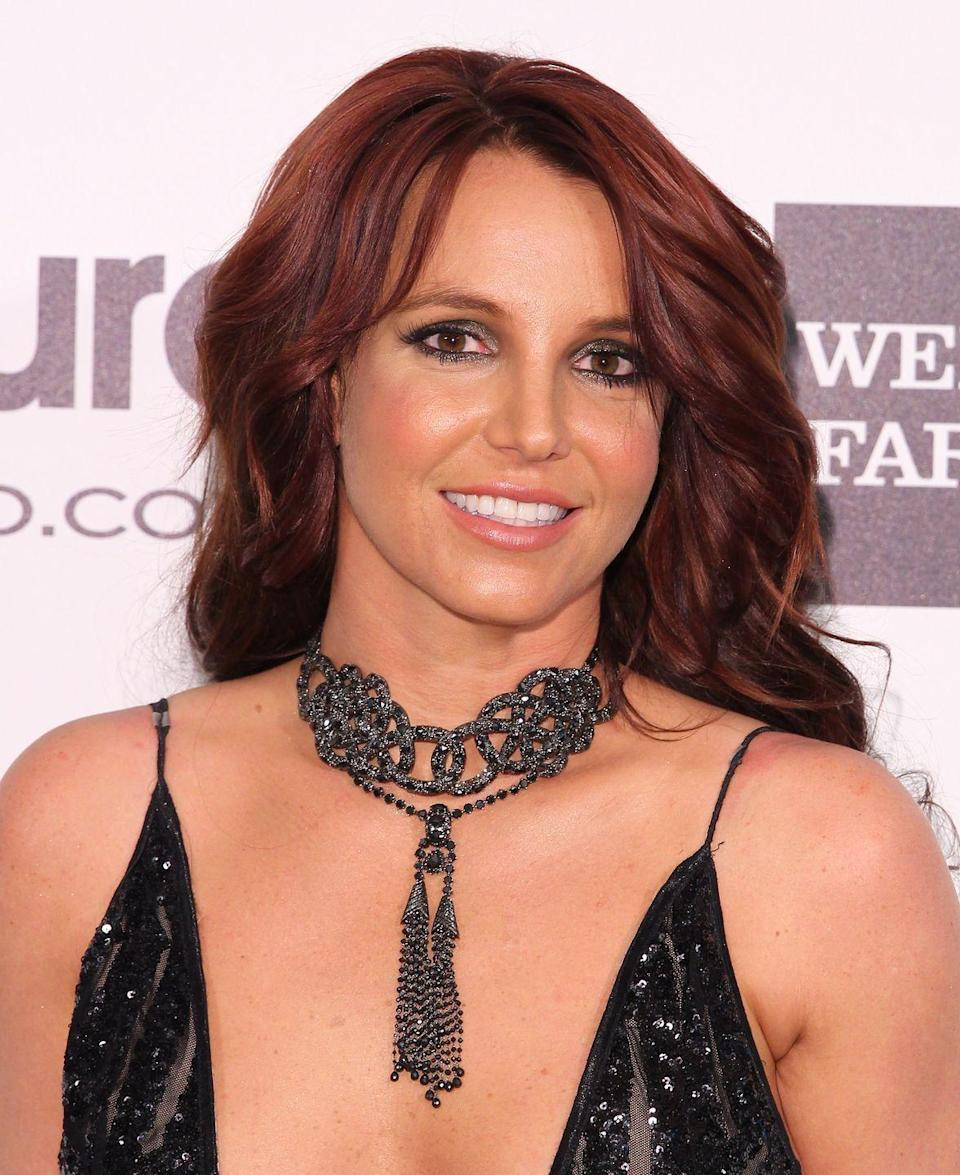 <p>Ready for <em>another </em>brand-new look? Britney arrived at Elton John's AIDS Foundation Gala with purple-y red hair.</p>