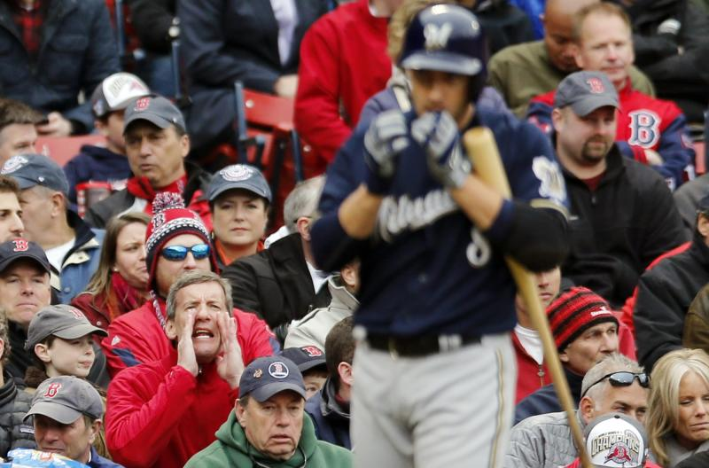 A fan jeers as Milwaukee Brewers' Ryan Braun comes up to bat in the seventh inning of a baseball game against the Boston Red Sox in Boston, Friday, April 4, 2014. (AP Photo/Michael Dwyer)