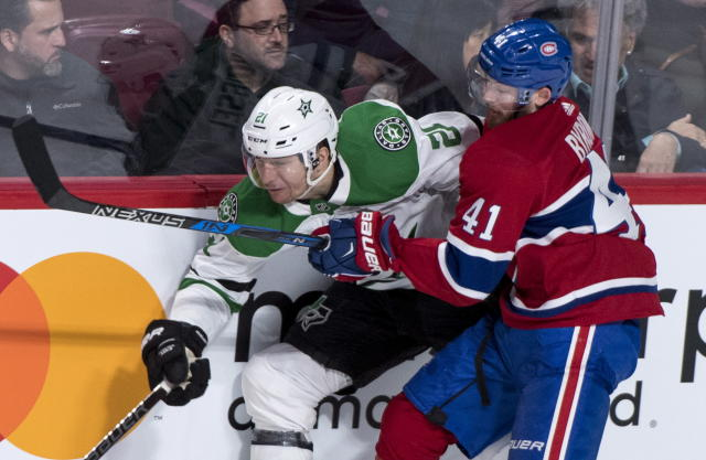 Dallas Stars left wing Antoine Roussel (21) is stopped by Montreal Canadiens left wing Paul Byron (41) during the first period of an NHL hockey game, Tuesday, March 13, 2018, in Montreal. (Paul Chiasson/The Canadian Press via AP)