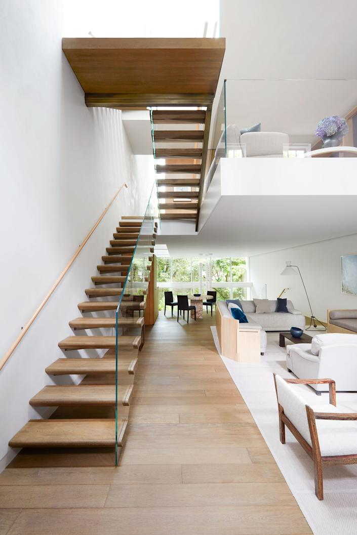 "<div class=""caption""> A floating staircase rises through the house. on the parlor level, a sofa by <a href=""https://www.stevenvolpe.com/"" rel=""nofollow noopener"" target=""_blank"" data-ylk=""slk:Studio Volpe"" class=""link rapid-noclick-resp"">Studio Volpe</a> wearing a <a href=""https://www.chapastextiles.com/"" rel=""nofollow noopener"" target=""_blank"" data-ylk=""slk:Chapas Textiles"" class=""link rapid-noclick-resp"">Chapas Textiles</a> fabric wraps around a c. 1928 Jean-Michel Frank cocktail table. C. 1952 floor lamp by Robert Mathieu for <a href=""https://www.arteluceonline.com/en/"" rel=""nofollow noopener"" target=""_blank"" data-ylk=""slk:ArteLuce"" class=""link rapid-noclick-resp"">ArteLuce</a>. </div> <cite class=""credit"">Thomas Loof</cite>"