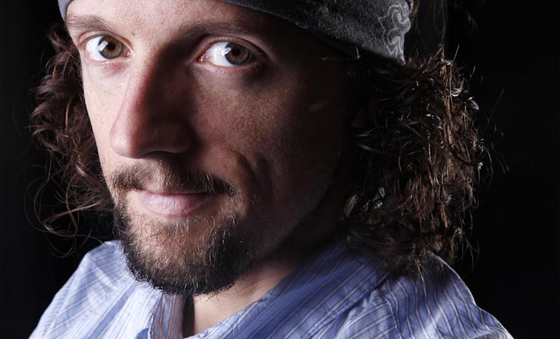 "In this March 8, 2012 photo, musician Jason Mraz poses for a portrait in New York. The singer-songwriter, known for feel-good and hippie hits like ""I'm Yours"" and ""The Remedy (I Won't Worry),"" released his latest album ""Love Is a Four Letter Word,"" on Tuesday. (AP Photo/Carlo Allegri)"
