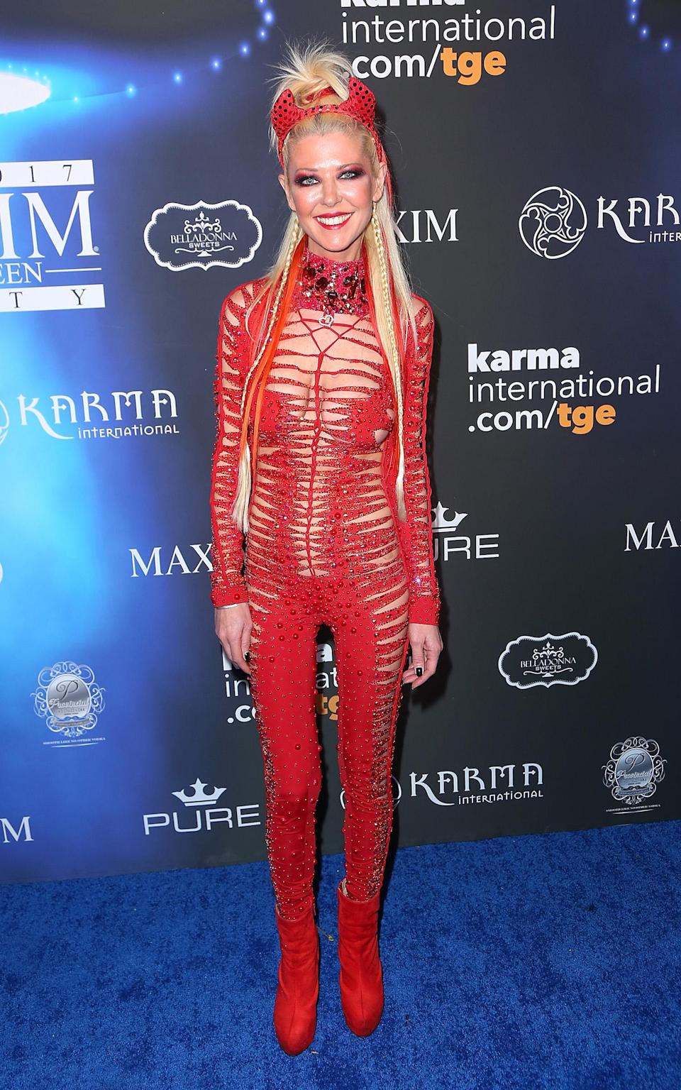 <p>Always one to dress up for Halloween, <em>Sharknado</em>'s Tara Reid was a sexy … something this year. (Photo: Getty Images) </p>