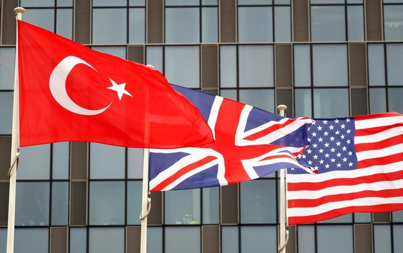 Turkish, British and U.S. flags flutter at NATO headquarters in Brussels