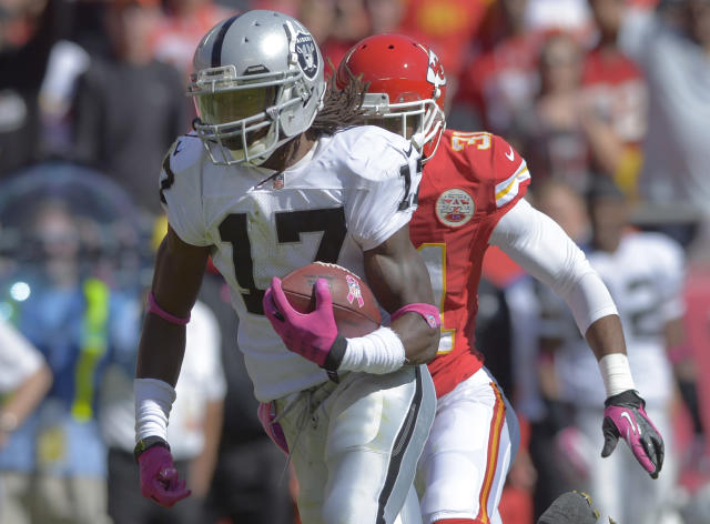 Oakland Raiders wide receiver Denarius Moore (17) runs past Kansas City Chiefs cornerback Marcus Cooper (31) for a touchdown during the first half of an NFL football game at Arrowhead Stadium in Kansas City, Mo., Sunday, Oct. 13, 2013. (AP Photo/Reed Hoffmann)