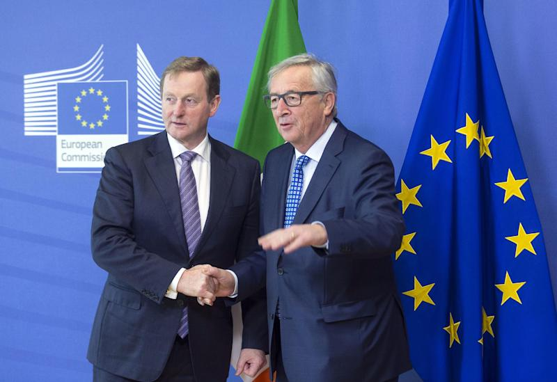 European Commission President Jean-Claude Juncker, right, speaks with Irish Prime Minister Enda Kenny prior to a meeting at EU headquarters in Brussels on Thursday, Feb. 23, 2017. (AP Photo)