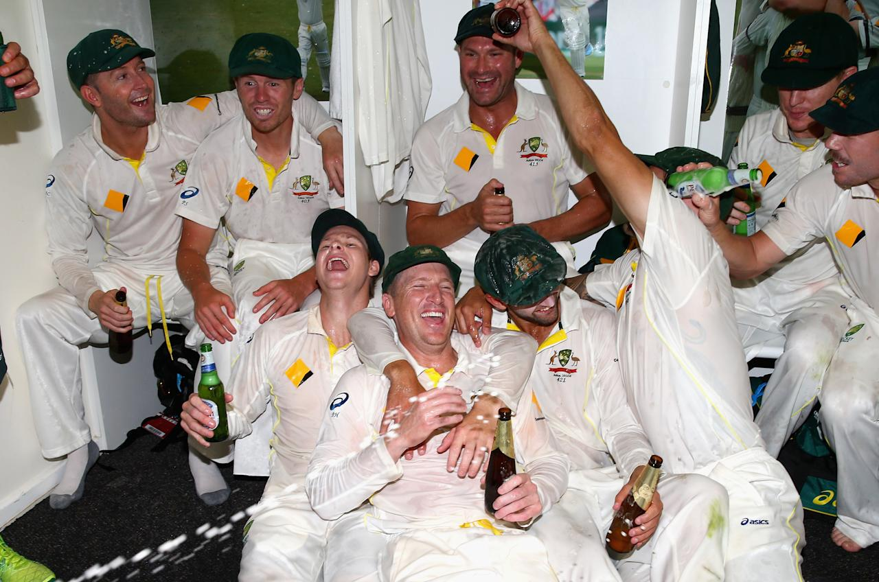 PERTH, AUSTRALIA - DECEMBER 17:  The Australian team celebrates victory in the change rooms during day five of the Third Ashes Test Match between Australia and England at WACA on December 17, 2013 in Perth, Australia.  (Photo by Ryan Pierse/Getty Images)