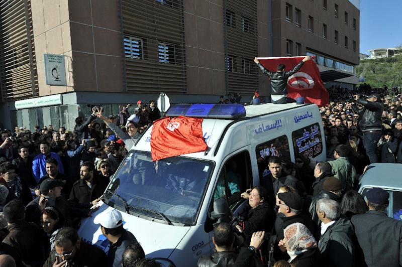 The body of Tunisian opposition leader Chokri Belaid, shot dead at close range on February 6, 2013, is transported in an ambulance from from a clinic in Tunis to the public hospital for an autopsy (AFP Photo/Fethi Belaid)