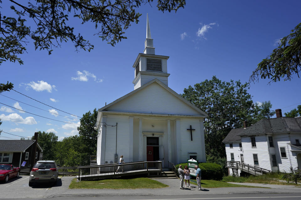 Members of 164-year-old Waldoboro United Methodist Church chat following a service, Sunday, June 20, 2021, in Waldoboro, Maine. The drop in attendance at the church, in part due to COVID-19, forced its closure. The last sermon was on June 27. (AP Photo/Robert F. Bukaty)