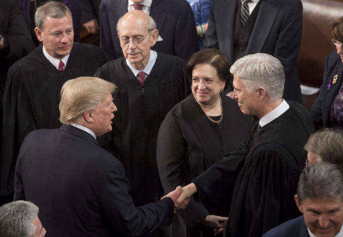 President Trump shakes hands with Supreme Court Justice Neil Gorsuch as Justices John Roberts, Stephen Breyer, and Elena Kagan look on, following Trump's State of the Union address Jan. 30, 2018. (Photo: Saul Loeb/AFP/Getty Images)