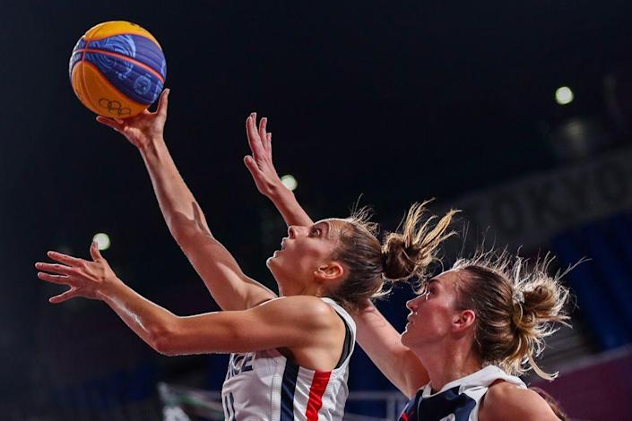 <p>Ana Maria Filip of France goes up for a shot against team Russia during the first round of the women's 3x3 basketball match.</p>