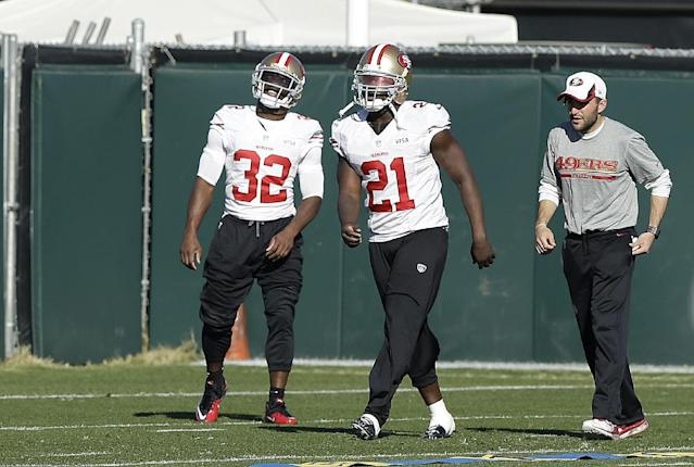 San Francisco 49ers running backs Frank Gore (21) and Kendall Hunter (32) practice at an NFL football training facility in Santa Clara, Calif., Wednesday, Jan. 15, 2014. The 49ers are scheduled to play the Seattle Seahawks for the NFC Championship on Sunday. (AP Photo/Jeff Chiu)
