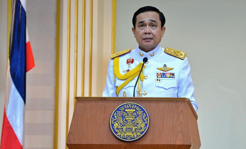 Thai Army Chief General Prayut Chan-O-Cha reads a statement after receiving a royal command during a ceremony to swear him in as Prime Minister at the Army headquarters in Bangkok on August 25, 2014 (AFP Photo/Government House)
