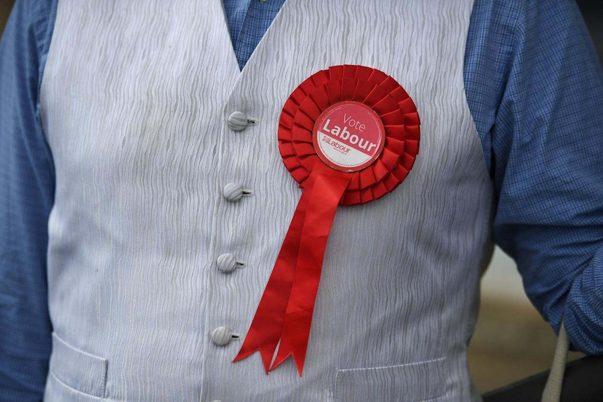 A Labour supporter sports a rosette in Batley, West Yorkshire on June 26, 2021, ahead of the Batley and Spen by-election taking place on July 1. (Photo by Oli SCARFF / AFP) (Photo by OLI SCARFF/AFP via Getty Images)