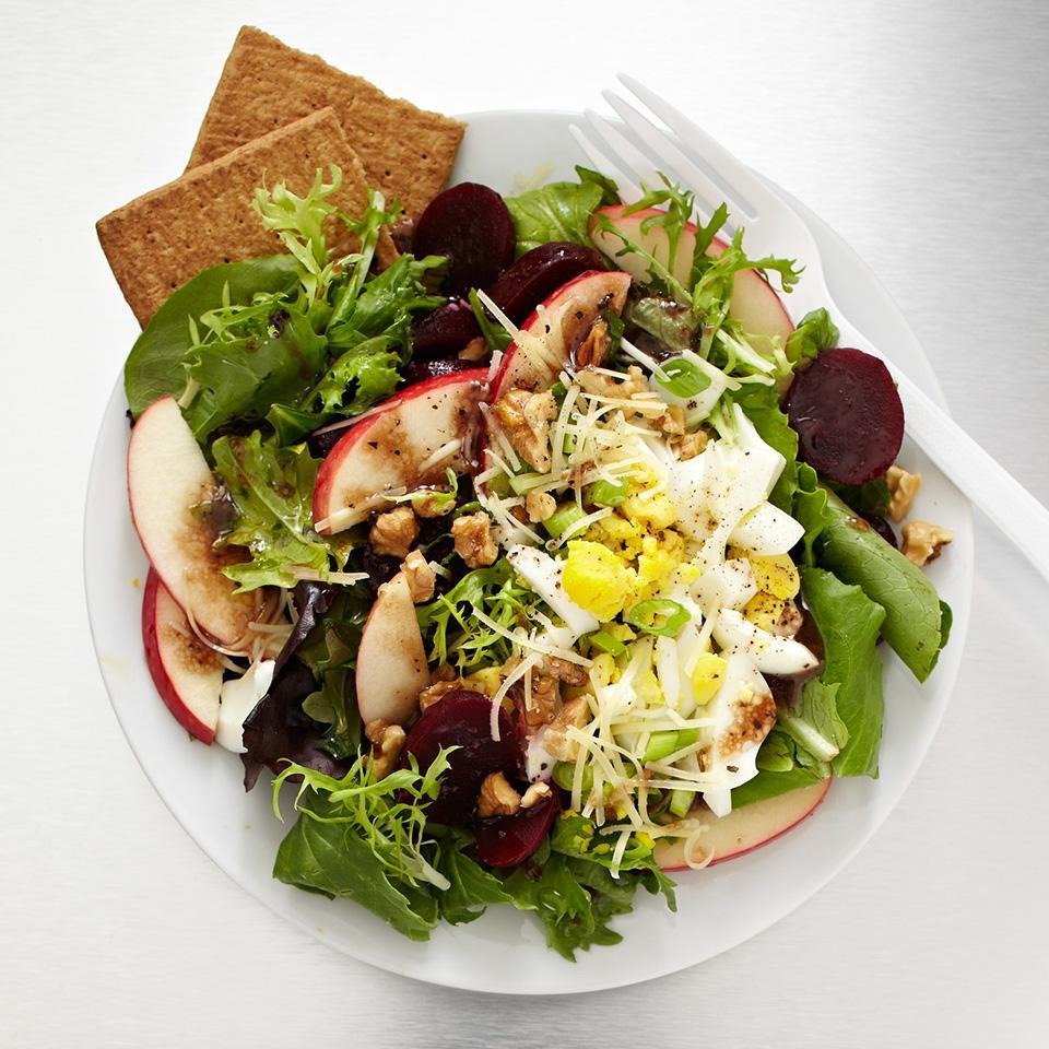 <p>Beets, raspberry vinaigrette, and apples make this salad the perfect answer to a sweet craving. This salad has just 343 calories, plus, thanks to its main ingredient -- beets -- you get a forkful of potassium and folate.</p>