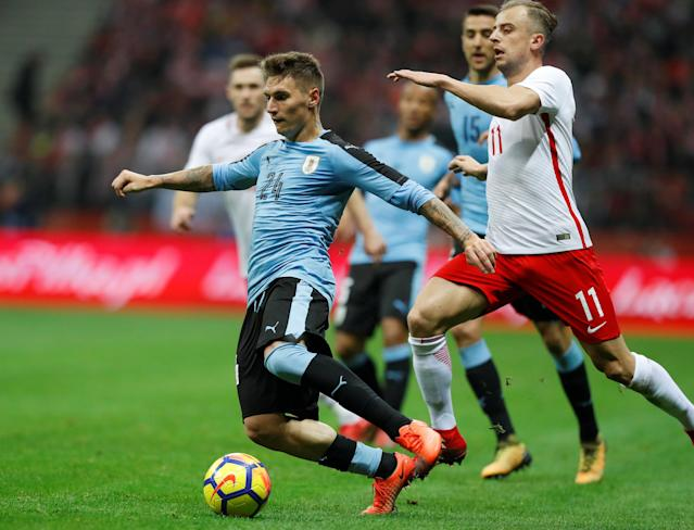 Soccer Football - International Friendly - Poland v Uruguay - National Stadium Warsaw, Warsaw, Poland - November 10, 2017 Uruguay's Gullermo Varela in action with Poland's Kamil Grosicki REUTERS/Kacper Pempel
