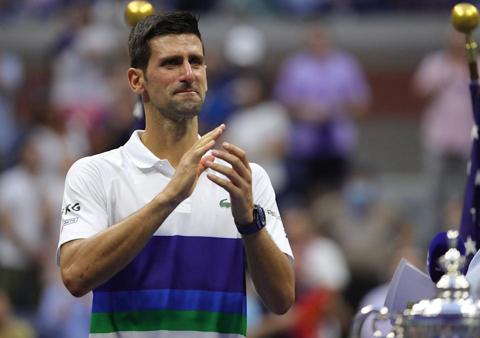 Serbia's Novak Djokovic applauds the crowd after losing to Russia's Daniil Medvedev during their 2021 US Open Tennis tournament men's final match at the USTA Billie Jean King National Tennis Center in New York, on September 12, 2021. (Photo by Kena Betancur / AFP) (Photo by KENA BETANCUR/AFP via Getty Images)