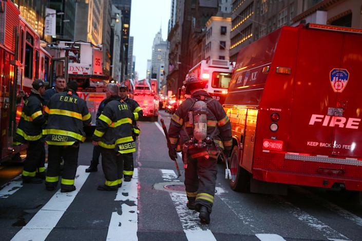 <p>First responders work on a fire in a residential unit at Trump tower in the Manhattan borough of New York City, New York, April 7, 2018. (Photo: Amr Alfiky/Reuters) </p>