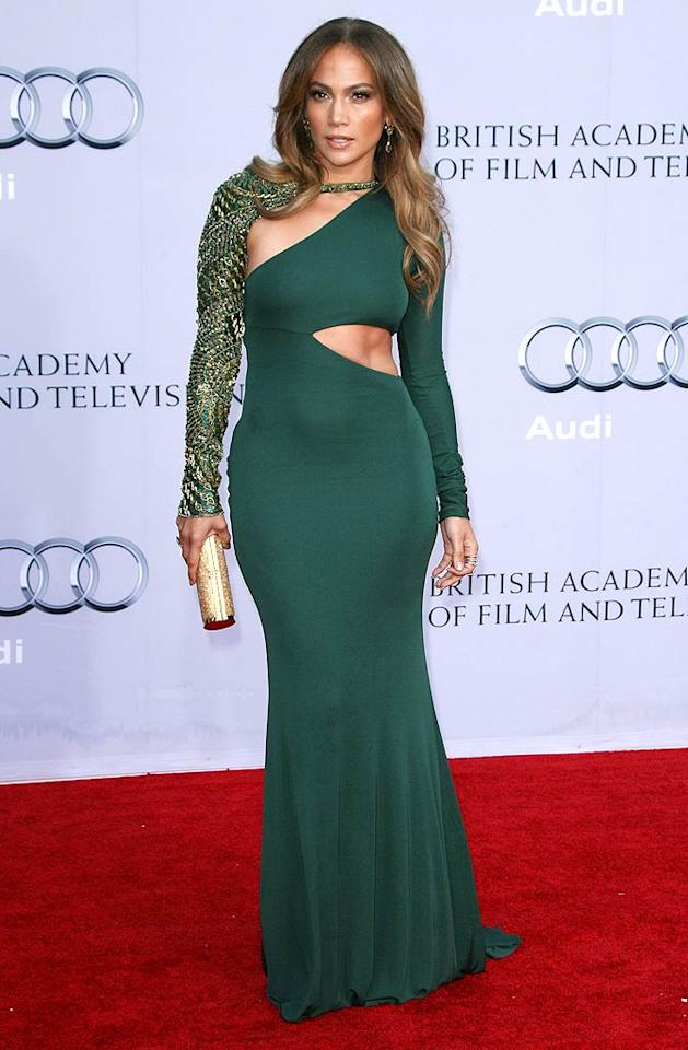 "I'm on the fence with the $4,700 Emilio Pucci gown Jennifer Lopez donned the other night. I like the color and the ab-baring cutout, but that chain-adorned sleeve and overall silhouette seem a bit extreme. Discuss. Jen Lowery/<a href=""http://www.splashnewsonline.com"" target=""new"">Splash News</a> - July 9, 2011"