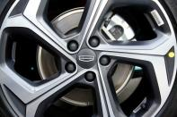 The Geely logo is seen on a rim at a car dealership in Shanghai