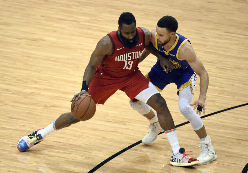 Houston Rockets' James Harden (13) works against Golden State Warriors' Stephen Curry during the second half of Game 6 of a second-round NBA basketball playoff series, Friday, May 10, 2019, in Houston. (AP Photo/Eric Christian Smith)