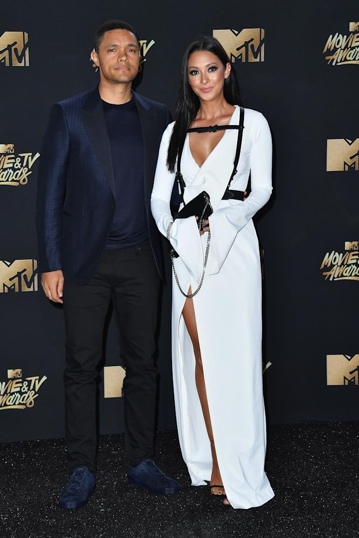 TV personality Trevor Noah (L) and singer Jordyn Taylor attend the 2017 MTV Movie and TV Awards at The Shrine Auditorium on May 7, 2017 in Los Angeles, California.