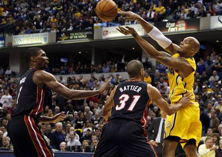 Indiana Pacers forward David West (21) makes a pass as he is double teamed by Miami Heat forward Shane Battier (31) and center Chris Bosh (1) at Bankers Life Fieldhouse. Mandatory Credit: Brian Spurlock-USA TODAY