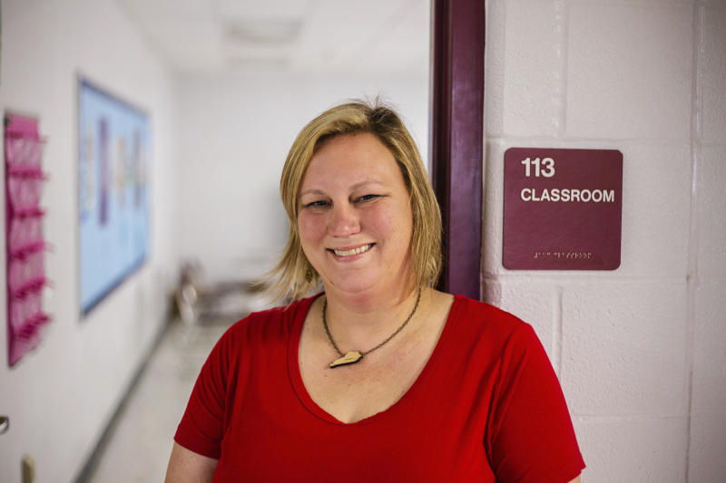 In this Oct. 13, 2018 photo made available by Robert Osborne, Jenny Urie stands near a classroom in Kentucky. Urie and 36 current and former educators ran for a seat in the Kentucky legislature, two-thirds of them lost. Months after massive teacher walkouts energized many like never before, teachers and their unions are coming to terms with the midterm elections' mix of wins and losses. (Robert Osborne via AP)