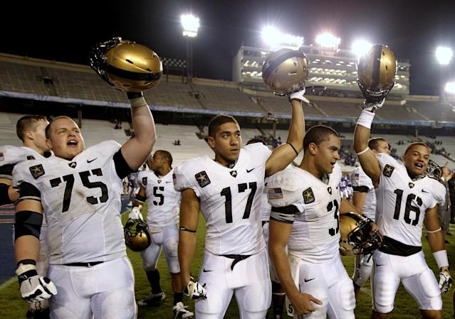 Army's Zach Reichert (75), Tyler Dickson (17), Angel Santiago (3) and Lamar Johnson-Harris (16) celebrate their 35-16 win in an NCAA college football game against Louisiana Tech, Saturday, Sept. 28, 2013, in Dallas. (AP Photo/Tony Gutierrez)
