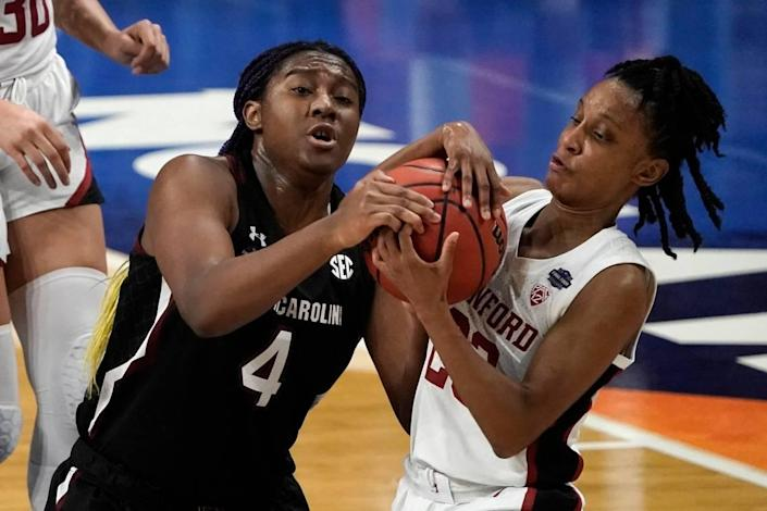 South Carolina forward Aliyah Boston (4) fights for possession of the ball with Stanford guard Kiana Williams, right, during the first half of a women's Final Four NCAA college basketball tournament semifinal game Friday, April 2, 2021, at the Alamodome in San Antonio.