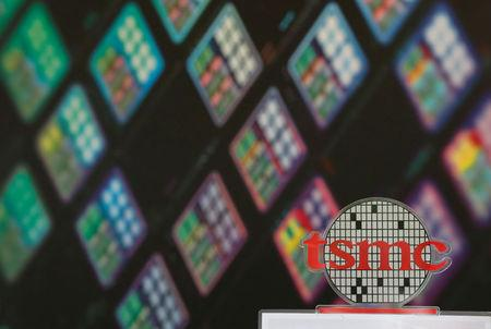 FILE PHOTO: A logo of Taiwan Semiconductor Manufacturing Co (TSMC) is seen at its headquarters in Hsinchu