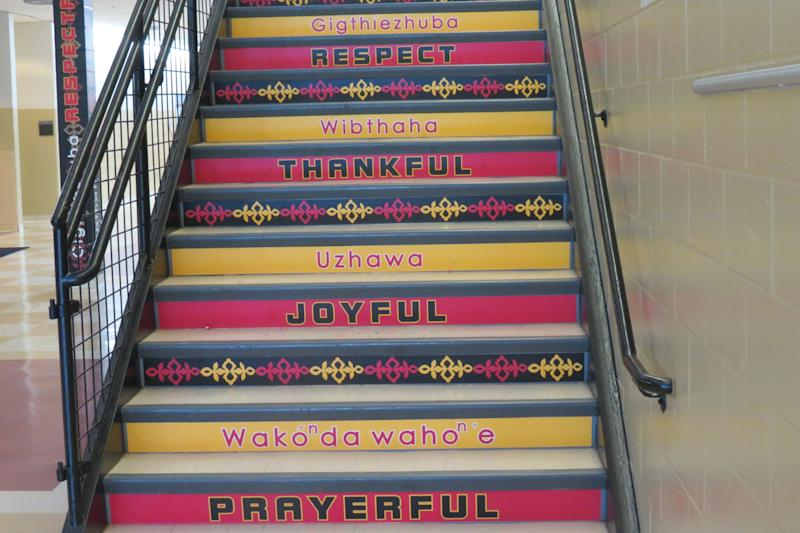 Stairs in UmonhonNation Public School with words in English and Umonhon. (Umonhon Nation Public Schools)