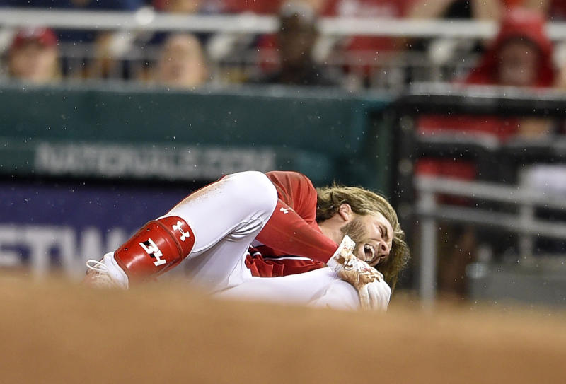Bryce Harper exits early with apparent serious knee injury