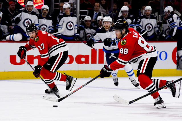 Chicago Blackhawks right wing Patrick Kane (88) and center Dylan Strome (17) move the puck during the first period of an NHL hockey game against the Winnipeg Jets on Saturday, Oct. 12, 2019, in Chicago. (AP Photo/Matt Marton)
