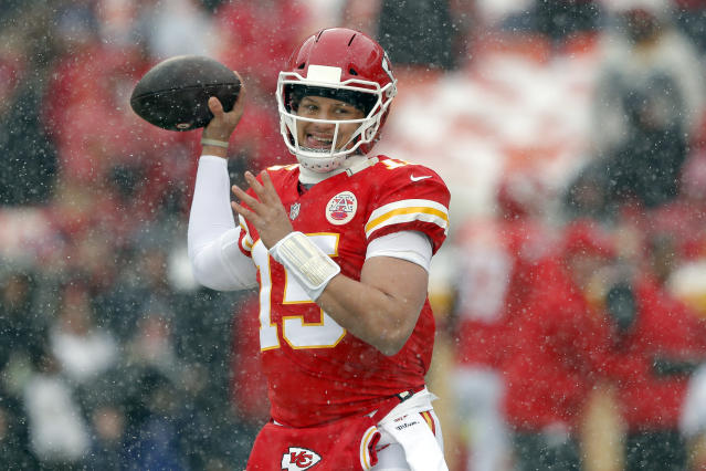 Kansas City Chiefs quarterback Patrick Mahomes (15) warms up as snow falls before an NFL divisional football playoff game against the Indianapolis Colts in Kansas City, Mo., Saturday, Jan. 12, 2019. (AP Photo/Charlie Neibergall)