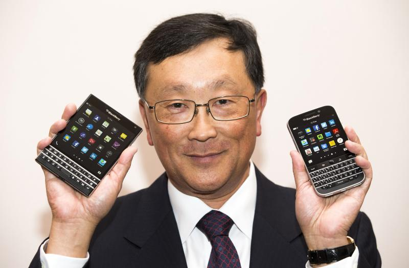 BlackBerry CEO Chen holds up the unreleased Blackberry Passport and Blackberry Classic devices during the company's annual general meeting for shareholders in Waterloo