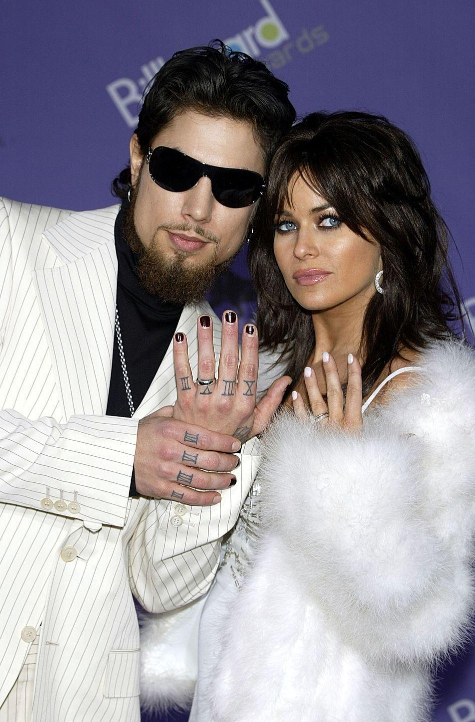 <p>Carmen Electra serves us a fuzzy white fur moment, while her then hubby, rocker Dave Navarro, gets a little gangster in a white pinstripe suit. The pair shared their lives with MTV cameras in <em>'Til Death Do Us Part </em>for two seasons.</p>