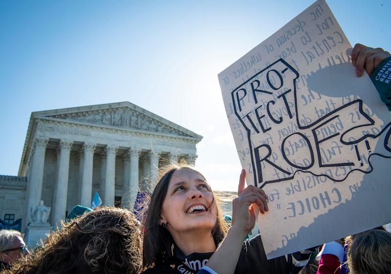 Activists rally outside the Supreme Court on March 4 during oral arguments for an abortion-related case, June Medical Services v. Russo.