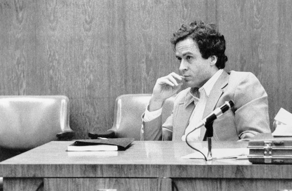 (Original Caption) Orlando, Fla.: Theodore Bundy watches intently during the third day of jury selection at his trial in Orlando for the murder of 12-year-old Kimberly Leach.