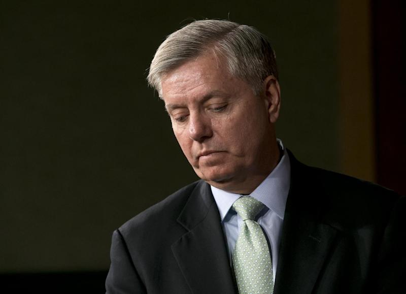 "Sen. Lindsey Graham, R-S.C. pauses during a news conference on Capitol Hill In Washington, Thursday, March 7, 2013, on the capture of Osama Bin Laden's son-in-law Sulaiman Abu Ghaith. Sulaiman Abu Ghaith , Osama bin Laden's spokesman and son-in-law has been captured by U.S. intelligence officials, officials said Thursday, in what a senior congressman called a ""very significant victory"" in the ongoing fight against al-Qaida. (AP Photo/J. Scott Applewhite)"