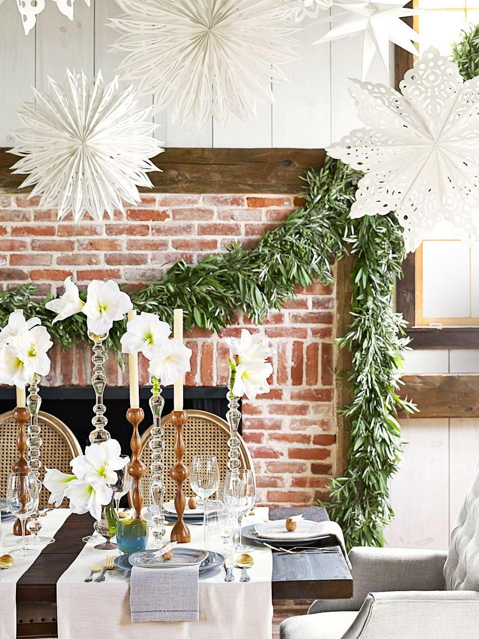 <p>There are pretty paper snowflakes and there are pretty paper snowflakes that also happen to be 3D. Hang them overhead near your holiday dinner table. For a complete winter wonderland atmosphere, stick to an all-white look with some fresh greenery sprinkled in.</p>
