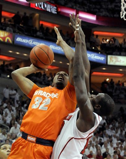 Syracuse's Kris Joseph (32) shoots over Louisville's Gorgui Dieng during the first half of their NCAA college basketball game, Monday, Feb. 13, 2012, in Louisville, Ky. (AP Photo/Timothy D. Easley)