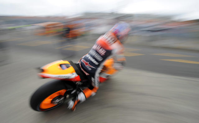 Honda rider Casey Stoner of Australia leaves the pit for the warm up session of the MotoGP class race of the motorcycle Grand Prix of Japan at the Twin Ring Motegi circuit in Motegi on October 2, 2011. Australian Moto GP world championship leader Stoner will start on pole position. AFP PHOTO / TOSHIFUMI KITAMURA (Photo credit should read TOSHIFUMI KITAMURA/AFP/Getty Images)