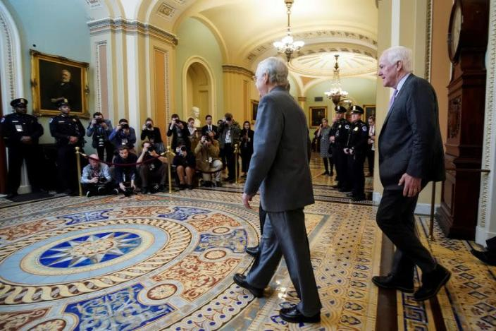 Senate Majority Leader McConnell and Senator Cornyn arrive for the beginning of the Trump impeachment trial in Washington